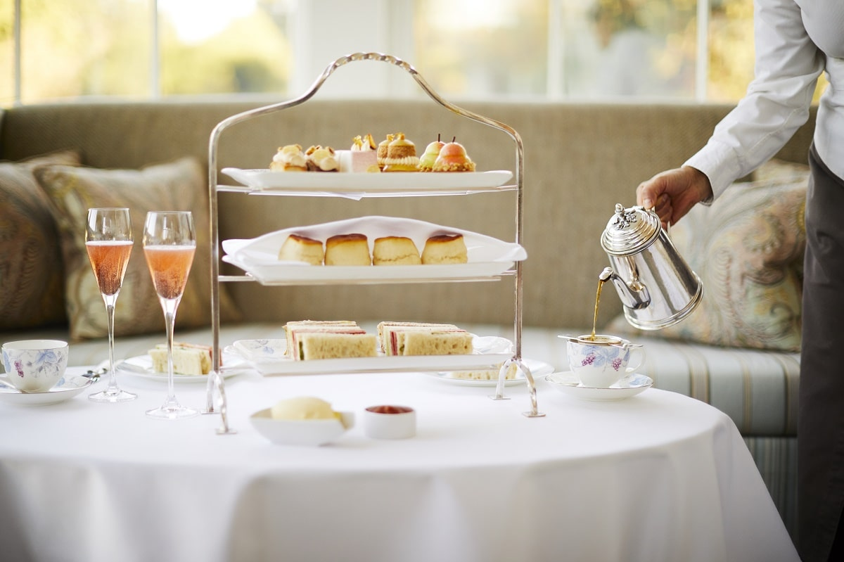 Coworth Park-Drawing Room Conservatory-Orchard Afternoon tea-tea pouring-highres1-min
